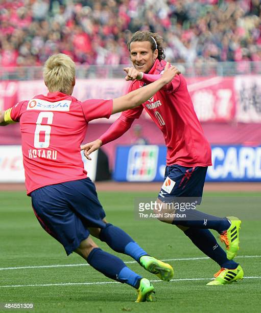 Diego Forlan of Cerezo Osaka celebrates scoring his team's first goal with his teammate Hotaru Yamaguchi during the JLeague match between Cerezo...