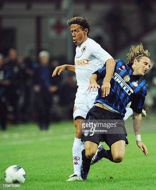 Diego Forlan of FC Internazionale Milano clashes with Rodrigo Taddei of AS Roma during the Serie A match between FC Internazionale Milano and AS Roma...