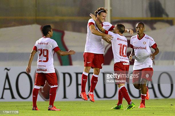 Diego Forlan of Internacional celebrates a scored goal during the match between Fluminense and Internacional a as part of Brazilian Championship 2013...