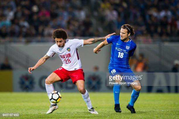 Diego Forlan of Kitchee SC fights for the ball Axel Witsel of Tianjin FC during the AFC Champions League 2018 Group E match between Kitchee SC vs...