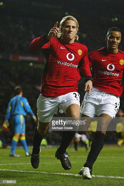 Diego Forlan of Man Utd celebrates after scoring the third goal during the FA Barclaycard Premiership match between Manchester United and Aston Villa...