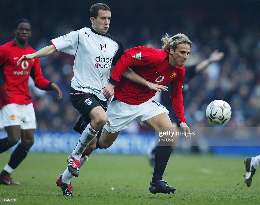 Diego Forlan of Manchester United battles with Adam Green of Fulham during the FA Barclaycard Premiership match between Fulham and Manchester United at Loftus Road on February 28, 2004 in London.
