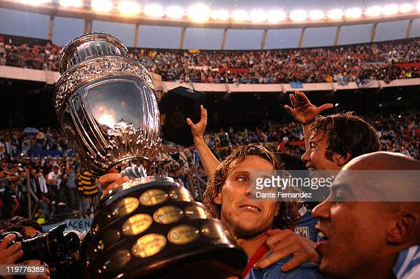 Diego Forlan of Uruguay celebrate after winning the Copa America 2011 at Antonio Vespucio Liberti Stadium on July 24 2011 in Buenos Aires Argentina