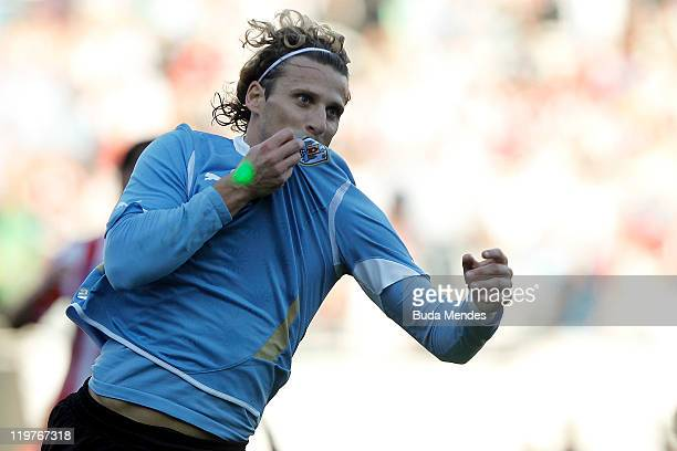 Diego Forlan of Uruguay celebrates scored goal during the Copa America 2011 final match between Uruguay and Paraguay at Monumental Antonio Vespucio...