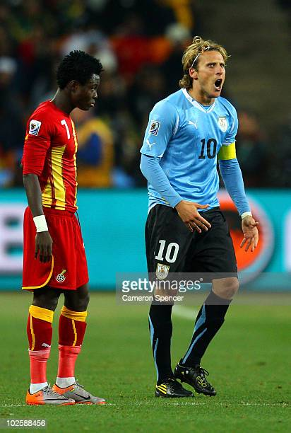 Diego Forlan of Uruguay celebrates scoring his team's first goal from a free kick during the 2010 FIFA World Cup South Africa Quarter Final match...