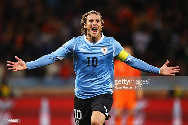 Diego Forlan of Uruguay celebrates scoring the equalising goal during the 2010 FIFA World Cup South Africa Semi Final match between Uruguay and the...