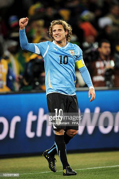 Diego Forlan of Uruguay celebrates winning the penalty shoot out and progress to the semi finals during the 2010 FIFA World Cup South Africa Quarter...