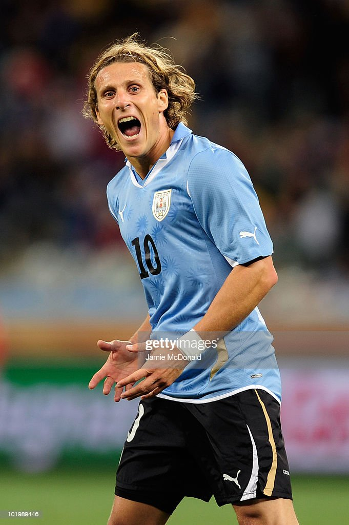 Diego Forlan of Uruguay gestures during the 2010 FIFA World Cup South Africa Group A match between Uruguay and France at Green Point Stadium on June 11, 2010 in Cape Town, South Africa.