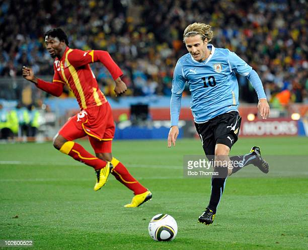 Diego Forlan of Uruguay in action during the 2010 FIFA World Cup South Africa Quarter Final match between Uruguay and Ghana at the Soccer City...
