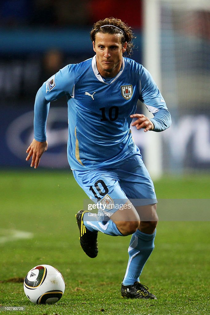 Diego Forlan of Uruguay in action during the 2010 FIFA World Cup South Africa Third Place Play-off match between Uruguay and Germany at The Nelson Mandela Bay Stadium on July 10, 2010 in Port Elizabeth, South Africa.