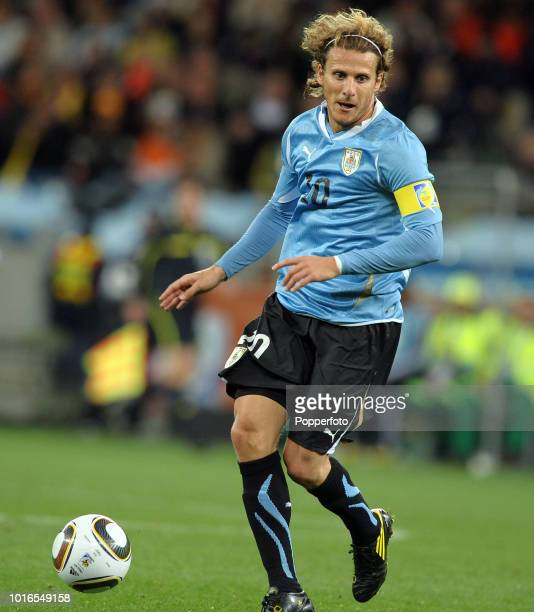 Diego Forlan of Uruguay in action during the 2010 FIFA World Cup Semi Final match between Uruguay and the Netherlands at Green Point Stadium in Cape...