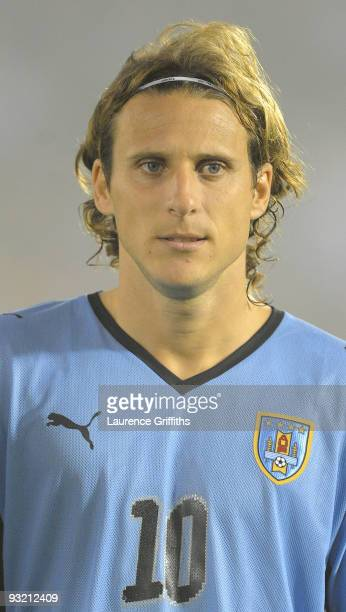 Diego Forlan of Uruguay lines up for the National Anthem duing the 2010 FIFA World Cup Play Off Second Leg Match between Uruguay and Costa Rica at...