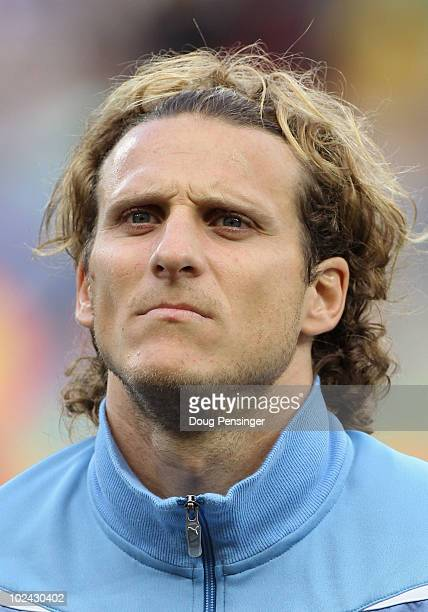 Diego Forlan of Uruguay lines up for the national anthems prior to the 2010 FIFA World Cup South Africa Round of Sixteen match between Uruguay and...