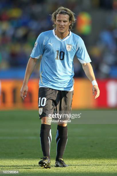 Diego Forlan of Uruguay looks on during the 2010 FIFA World Cup South Africa Group A match between Mexico and Uruguay at the Royal Bafokeng Stadium...