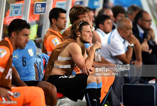 Diego Forlan of Uruguay looks on the bench after being replaced during the 2014 FIFA World Cup Brazil Round of 16 match between Colombia and Uruguay...