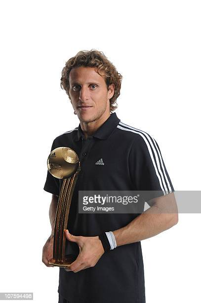 Diego Forlan of Uruguay poses with the adidas Golden Ball Winner Trophy at the adidas HQ on December 14 2010 in Herzogenaurach Germany