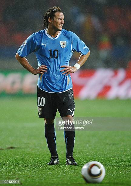 Diego Forlan of Uruguay prepares to take a free kick during the 2010 FIFA World Cup South Africa Round of Sixteen match between Uruguay and South...