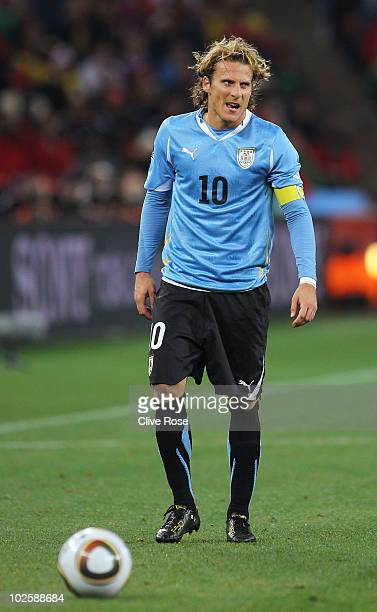Diego Forlan of Uruguay prepares to take a free kick during the 2010 FIFA World Cup South Africa Quarter Final match between Uruguay and Ghana at the...