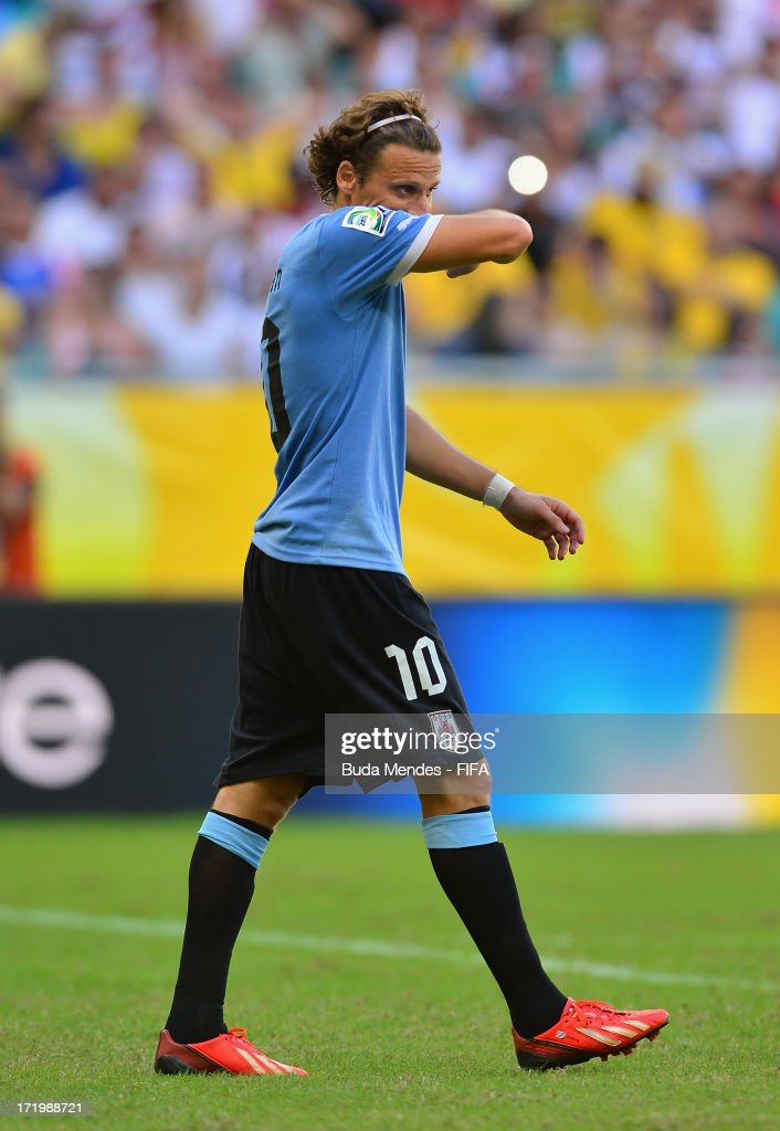 Diego Forlan of Uruguay reacts to missing a penalty during a shootout during the FIFA Confederations Cup Brazil 2013 3rd Place match between Uruguay and Italy at Estadio Octavio Mangabeira (Arena Fonte Nova Salvador) on June 30, 2013 in Salvador, Brazil.