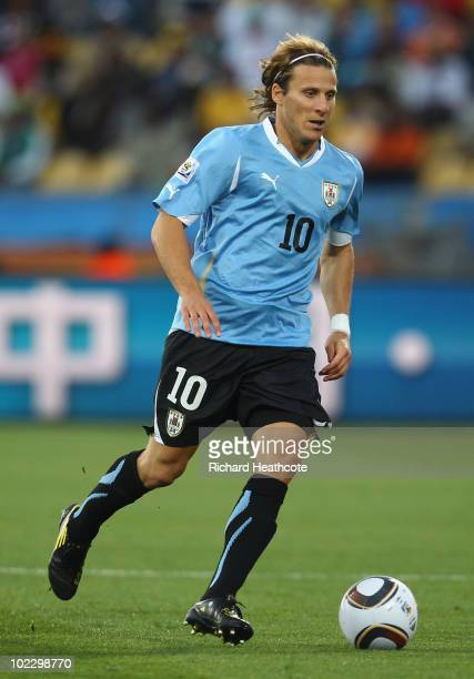 Diego Forlan of Uruguay runs with the ball during the 2010 FIFA World Cup South Africa Group A match between Mexico and Uruguay at the Royal Bafokeng...
