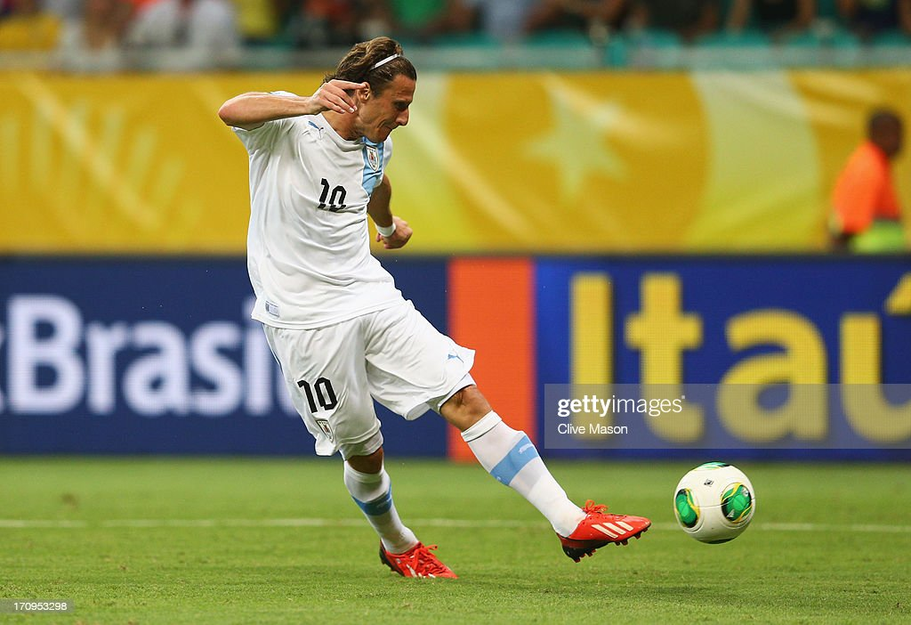 Diego Forlan of Uruguay scores his team's second goal during the FIFA Confederations Cup Brazil 2013 Group B match between Nigeria and Uruguay at Estadio Octavio Mangabeira (Arena Fonte Nova Salvador) on June 20, 2013 in Salvador, Brazil.