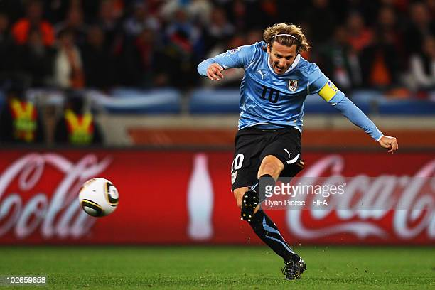 Diego Forlan of Uruguay scores the equalising goal during the 2010 FIFA World Cup South Africa Semi Final match between Uruguay and the Netherlands...