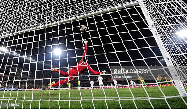 Diego Forlan of Uruguay shoots and scores a penalty against substitute goalkeeper Moneeb Josephs of South Africa during the 2010 FIFA World Cup South...