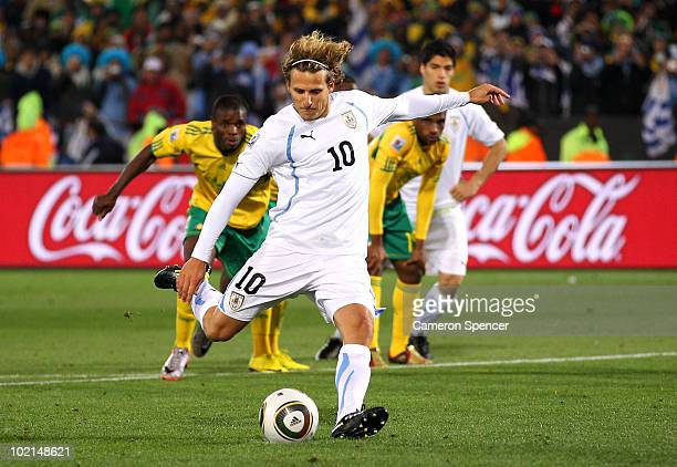 Diego Forlan of Uruguay shoots and scores a penalty during the 2010 FIFA World Cup South Africa Group A match between South Africa and Uruguay at...