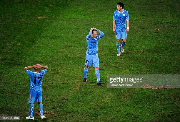Diego Forlan of Uruguay shows his dejection at the final whistle following the 2010 FIFA World Cup South Africa Third Place Playoff match between...