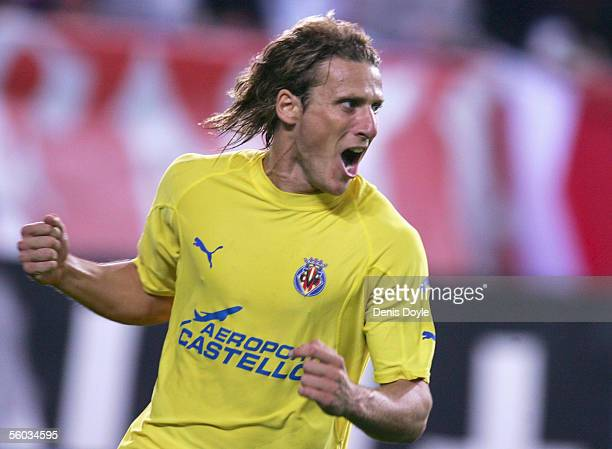 Diego Forlan of Villarreal celebrates after scoring the equalizer in the dying minutes of a Primera Liga match between Atletico Madrid and Villarreal...
