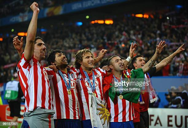 Diego Forlan Sergio Aguero Raul Garcia and Simao of Atletico Madrid celebrate their victory after extra time at the end of the UEFA Europa League...