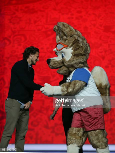 Diego Forlan shakes hands with the 2018 World Cup mascot during the Behind the Scenes of the Final Draw for the 2018 FIFA World Cup at the Draw hall...