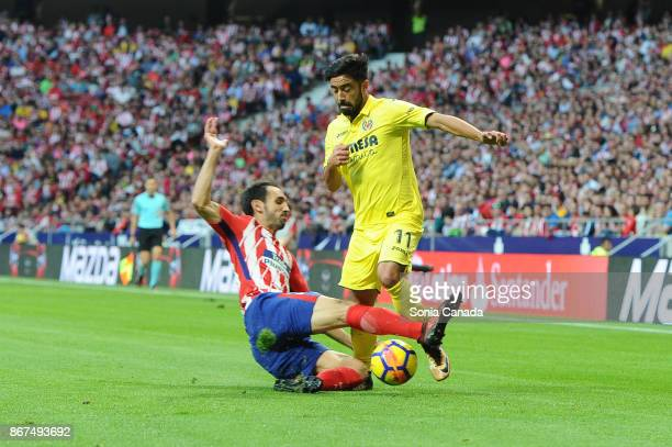 Diego Godin #2 of Atletico de Madrid and Costa #11 of Villareal during The La Liga match between Club Atletico de Madrid and Villareal at Wanda...