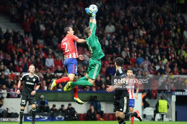 Diego Godin #2 of Atletico de Madrid and Ibrahim Sehic #13 of Qarabag during the UEFA Champions League group C match between Club Atletico de Madrid...
