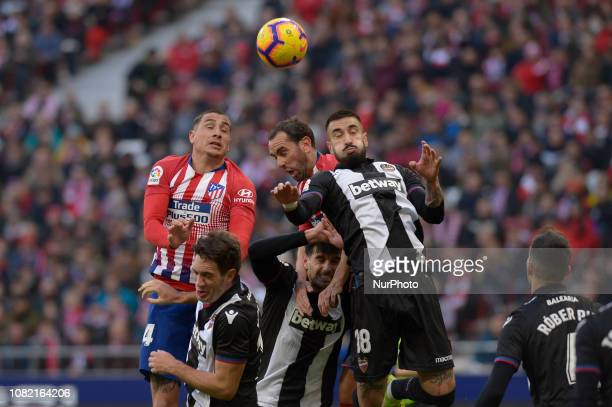 Diego Godin and Arias of Atletico de Madrid fight the ball with Cabaco of Levante during a match between Atletico de Madrid vs Levante for Spanish...