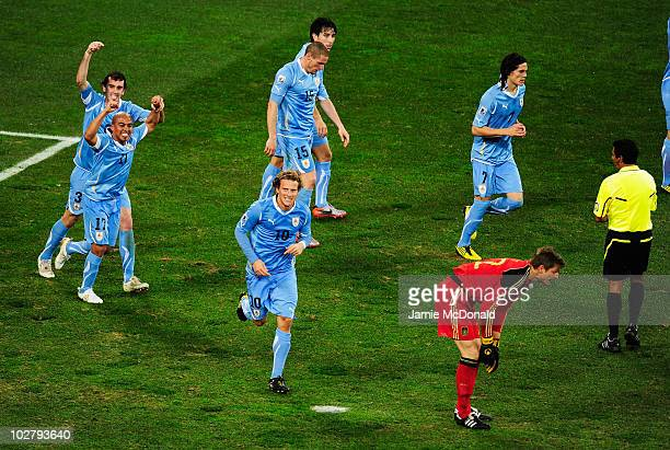 Diego Godin and Egidio Arevalo of Uruguay celebrate the goal scored by Diego Forlan during the 2010 FIFA World Cup South Africa Third Place Playoff...