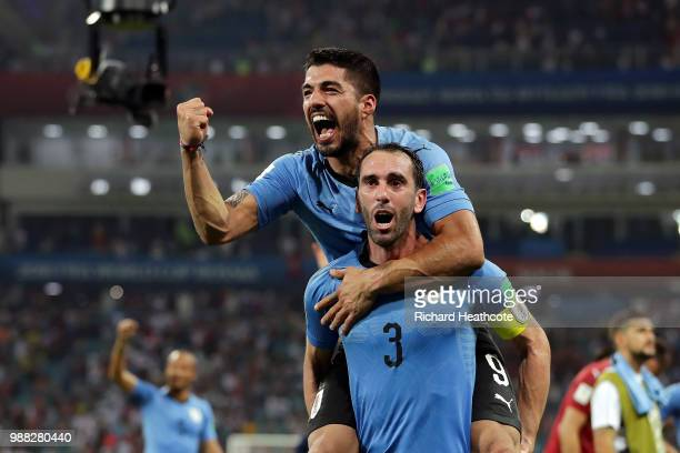 Diego Godin and Luis Suarez of Uruguay celebrate victory following the 2018 FIFA World Cup Russia Round of 16 match between Uruguay and Portugal at...