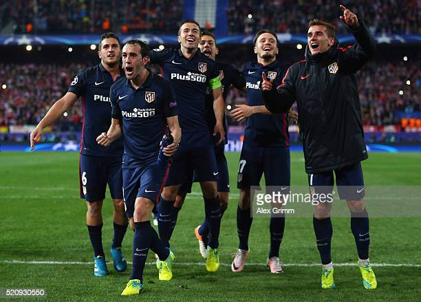 Diego Godin Antoine Griezmann and team mates of Atletico celebrate after the UEFA Champions League Quarter Final Second Leg match between Club...