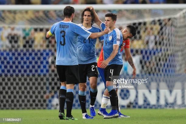 Diego Godin, Edinson Cavani and Giovanni Gonzalez of Uruguay celebrate after winning the Copa America Brazil 2019 group C match between Chile and...