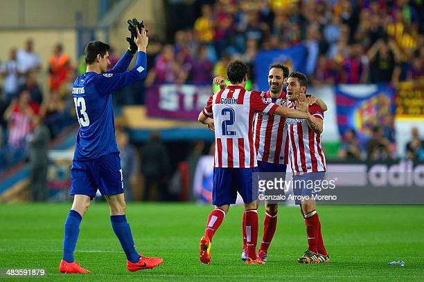 Diego Godin Juanfran and Koke of Club Atletico de Madrid hug as Thibaut Courtois of Club Atletico de Madrid applauds the fans during the UEFA...