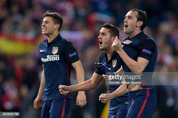 Diego Godin Koke and Lucas Hernandez Pi of Atletico de Madrid celebrate their victory with teammates after winning the UEFA Champions League quarter...