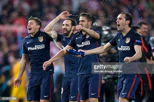 Diego Godin Koke Juan Francisco Torres alias Juanfran and Lucas Hernandez Pi of Atletico de Madrid celebrate their victory with teammates after...