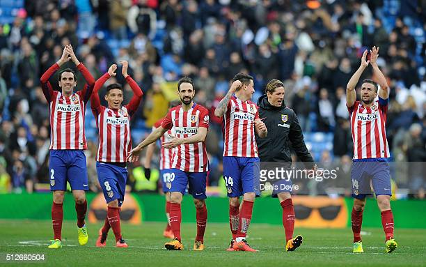 Diego Godin Matias Kranevitter Juanfran Jose Maria Gimenez Fernando Torres and Gabi Fernandez of Club Atletico de Madrid celebrate after they beat...