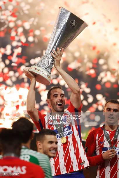 Diego Godin of Athletico Madrid holds the trophy during the UEFA Europa League Final between Olympique de Marseille and Club Atletico de Madrid at...
