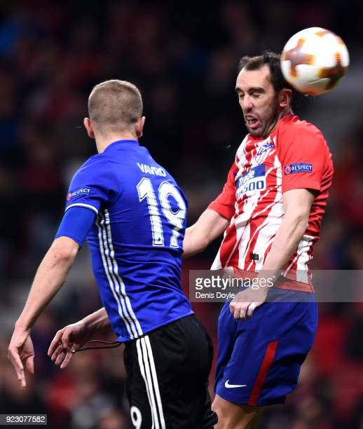 Diego Godin of Athletico Madrid wins a header ahead of Denis Vavro of FC Copenhagen during UEFA Europa League Round of 32 match between Atletico...