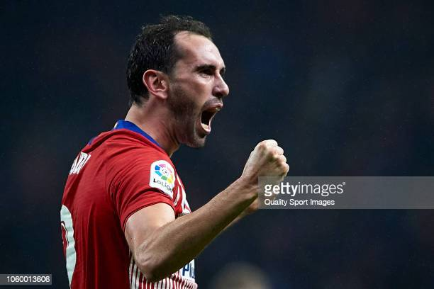 Diego Godin of Atletico de Madrid celebrates after scoring his team's third goal during the La Liga match between Club Atletico de Madrid and...