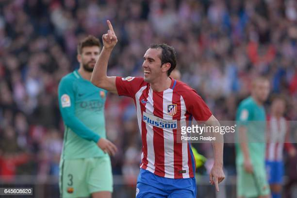 Diego Godin of Atletico de Madrid celebrates after scoring the first goal of his team during the La Liga match between Atletico Madrid and FC...
