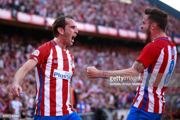 Diego Godin of Atletico de Madrid celebrates scoring their opening goal with teammate Saul Niguez during the La Liga match between Club Atletico de...