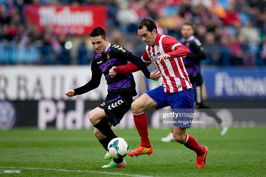 Diego Godin (R) of Atletico de Madrid competes for the ball with Antonio Rukavina (L) of Real Valladolid CF during the La Liga match between Club Atletico de Madrid and Real Valladolid CF at Vicente Calderon Stadium on February 15, 2014 in Madrid, Spain.