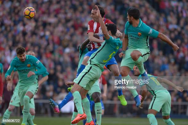 Diego Godin of Atletico de Madrid heads the ball to score the first goal of his team during the La Liga match between Atletico Madrid and FC...